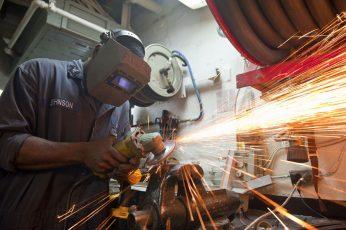 Wallpaper Man Wearing Gray Welding Mask While Grinding Metal