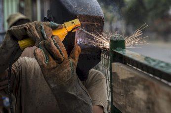 Wallpaper Person Wearing Welding Mask Welding On Green Metal