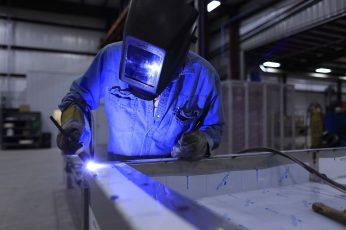 Wallpaper Welder Wearing Helmet And Blue Uniform, Welding
